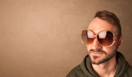 Portrait of a young funny man with sunglasses and copyspace royalty free stock images