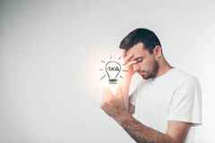 Portrait of young genious man holding lamp. Guy with an idea - isolated with clipping path Stock Photos