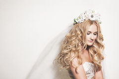 Portrait of Young Gentle Bride. Portrait of affectionate blond bride. Wedding makeup and hairdo. Wedding decoration Royalty Free Stock Image