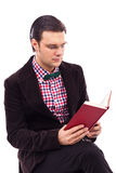 Portrait of a young gentleman reading a book Stock Images