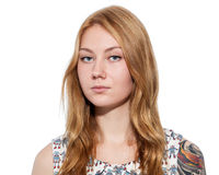 Portrait of a young ginger woman  with natural make up and tatto Stock Images