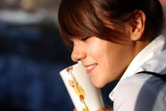Portrait of young girl. The young girl in a white blouse drinks juice on a balcony. Photo taken on october 2009 Royalty Free Stock Photo