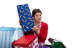 Portrait of a young girl. Unpacking her presents Royalty Free Stock Photography