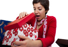Portrait of a young girl. Unpacking her presents Stock Photography