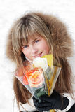 Portrait of the young girl. With a fair hair and roses royalty free stock photo