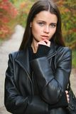 Portrait of the young girl. Autumn portrait of the young beautiful girl stock image