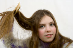 Portrait of the young girl. Combing hair stock images