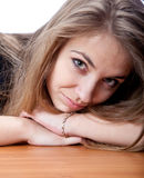 Portrait young girl. Attractive cheerful lying isolated on brown table Stock Photo
