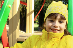 Portrait of a young girl. The smiling little girl on the playground Stock Image