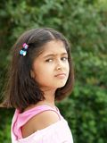 Portrait of young girl. Looking over shoulder Royalty Free Stock Photo