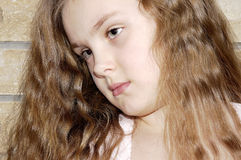 Portrait of the young girl. Portrait of the girl with the dismissed hair Royalty Free Stock Photos