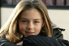 Portrait of a young girl. Portrait of a pretty girl wearing a coat Royalty Free Stock Image