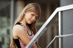 Portrait of young girl against a school building Royalty Free Stock Photography