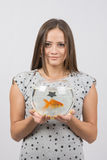 Portrait of a young girl with an aquarium with goldfish in the hands of a goldfish Stock Photography