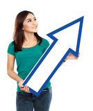 Portrait of young girl with arrow sign Stock Images