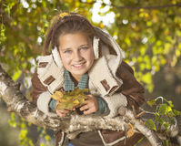 Portrait of young girl in autumn park Stock Photo