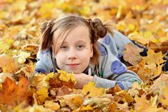 Portrait of a young girl in the autumn season stock photos