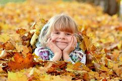 Portrait of a young girl in the autumn season stock images