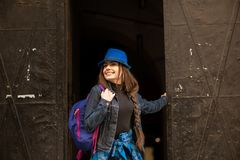 Portrait of a young girl on the background of the old black portal in the city of Lviv royalty free stock photos