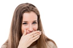Portrait of a young girl with a bad smell from her mouth. On a white background isolated stock photo