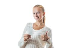 Portrait of a young girl with badge. Portrait of a young beautiful girl with badge isolated on white Stock Images