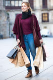 Portrait of young girl with bags from her shopping Stock Image