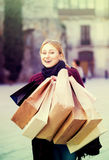 Portrait of young girl with bags from her shopping Stock Photos