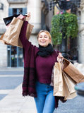 Portrait of young girl with bags from her shopping Stock Images