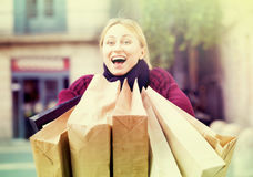 Portrait of young girl with bags from her shopping Stock Photo