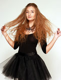 Portrait of a young girl ballerina in a black dress Royalty Free Stock Photo