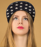 Portrait of a young girl in baseball cap Stock Image