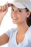 Portrait of young girl in baseball cap smiling. Portrait of attractive young girl in baseball cap, smiling at camera Royalty Free Stock Photo