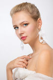 Portrait of a young girl. In the big earrings Stock Photo