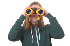 Girl with binoculars Royalty Free Stock Photography