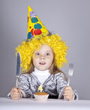 Portrait of young girl at birthday with cake. Royalty Free Stock Image