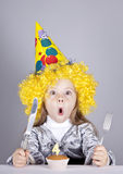 Portrait of young girl at birthday with cake. Royalty Free Stock Photography