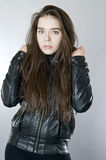 Portrait of a young girl in a black leather jacket. Stock Image