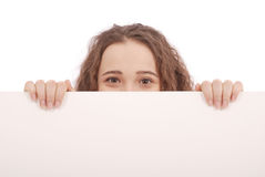 Portrait of a young girl with blank billboard isolated Stock Photography