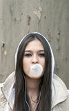 Portrait of young girl blowing bubble gum Royalty Free Stock Image