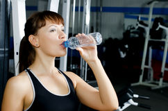Portrait of a young girl with a bottle of water Stock Photos