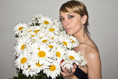 Portrait of a young girl with a bouquet Royalty Free Stock Photography