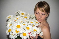 Portrait of a young girl with a bouquet Stock Image