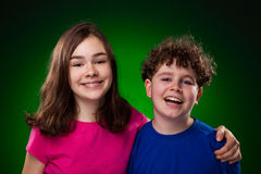 Portrait of young girl and boy. On green background Royalty Free Stock Photos