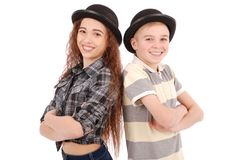 Portrait of young girl and boy posing in black bowler hat. Isolated on white Royalty Free Stock Image