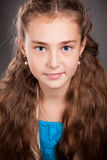 Portrait of a young girl with brown curly hair Royalty Free Stock Images