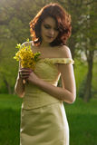 Portrait of young girl with bunch of flowers Stock Images