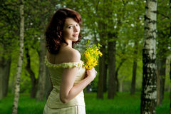 Portrait of young girl with bunch of flowers Royalty Free Stock Images