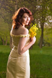 Portrait of young girl with bunch of flowers Stock Photography