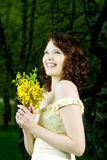 Portrait of young girl with bunch of flowers Stock Photo