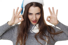 Portrait of young girl celebrating christmas and showing hand ok Royalty Free Stock Photography